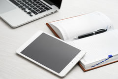 Tablet computer on desk Royalty Free Stock Photos