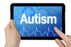 Tablet computer with diagnosis autism royalty free stock photography