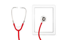 Tablet computer diagnostic and repair concept. Modern technology of tablet with touch screen. Red stethoscope on mobile computer. Isolated objects on white royalty free stock photos