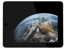 Tablet Computer with Earth Planet from Space royalty free stock photos
