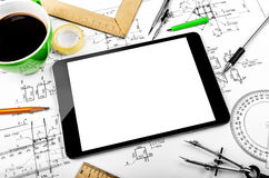 Tablet computer and engineering plan Royalty Free Stock Images