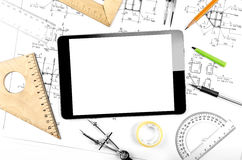 Tablet computer and engineering plan Royalty Free Stock Photo