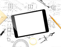 Tablet computer and engineering plan. Royalty Free Stock Photos