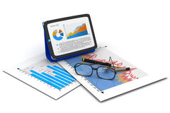 Tablet computer with Financial paper charts Stock Photos