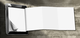 Tablet Computer with Folded Paper Stock Image