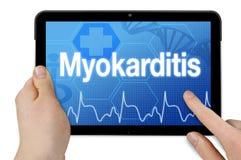Tablet computer with the german word for myocarditis - Myokarditis royalty free stock photo