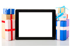 Tablet computer gift boxes royalty free stock photos