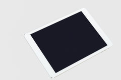 Tablet computer on grey background Royalty Free Stock Photo