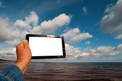 Tablet computer in hand. Royalty Free Stock Image