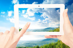 Tablet computer in hand Stock Photography