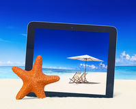 Tablet computer idyllic beach image Concept Stock Photo