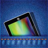 Tablet computer on jeans background Royalty Free Stock Images