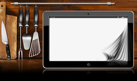Tablet Computer in the Kitchen Royalty Free Stock Images