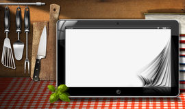Tablet Computer in the Kitchen Royalty Free Stock Photo