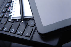 Tablet computer and laptop on desk Royalty Free Stock Photo