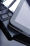 Tablet computer and laptop on desk Royalty Free Stock Images