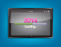 Tablet computer with loading bar. Tablet computer with the message 2014 and a loading bar on the screen Royalty Free Stock Photography