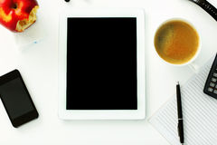 Tablet computer lying on the table Royalty Free Stock Photography