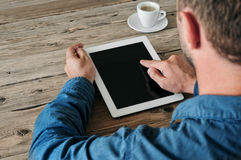 Tablet computer in men hands. Man presses on the blank screen tablet computer Stock Photo