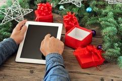 Tablet computer in men hands Stock Photos