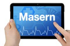 Tablet-Computer mit dem deutschen Wort für Masern - Masern stockfoto