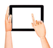 Tablet-Computer mit der hölzernen Hand lokalisiert Stockfotos