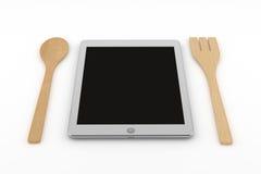 Tablet-Computer mit hölzernem Löffel und Gabel Lizenzfreie Stockfotografie