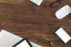tablet, computer notebook and mobile phone on office desk - top Royalty Free Stock Images