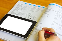 Tablet computer over engineering journal Stock Image
