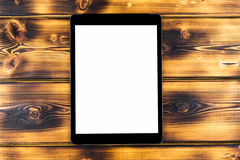 Tablet computer PC with blank screen mock up  on burned wood table background. Tablet on wood table. tablet white screen Royalty Free Stock Photos