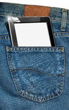 Tablet Computer in a Pocket of Blue Jeans Royalty Free Stock Image