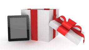 Tablet computer with present Royalty Free Stock Photography