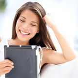 Tablet computer. Pretty asian woman holding tablet Royalty Free Stock Photo
