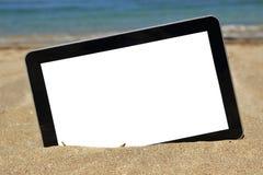 Tablet computer. On sandy beach Stock Image