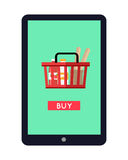 Tablet Computer with Shopping Basket on Screen. Tablet computer with full shopping basket on screen. Buy now icon. Shopping basket with products. Concept for Royalty Free Stock Image