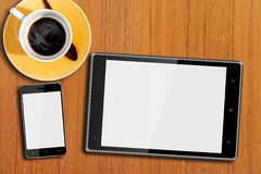 Tablet computer and Smart Phone on the Table Stock Photo