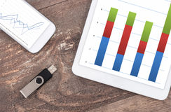 Tablet computer and smartphone with statistics charts Stock Photo