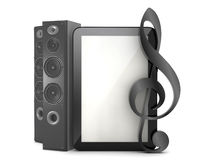 Tablet computer with sound system and clef Royalty Free Stock Photo