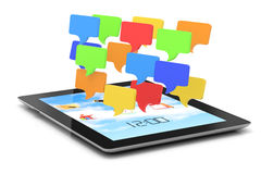 Tablet computer and speech bubbles Stock Photo