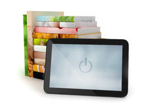 Tablet computer and stack of books Stock Photo
