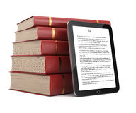 Tablet computer and stack of books Stock Images