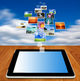 Tablet computer streaming images Royalty Free Stock Image