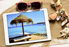 Tablet computer and summer stuff Royalty Free Stock Images
