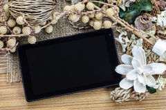 Tablet computer (tablet pc) and Dry flowers Royalty Free Stock Photo