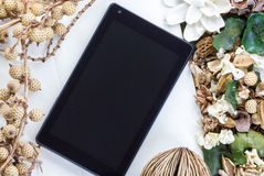 Tablet computer (tablet pc) and Dry flowers Stock Images