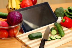 Tablet computer with vegetables Royalty Free Stock Photography