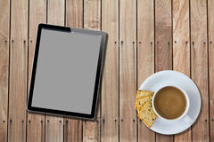 Tablet computer Wood Table with hot coffee Stock Image