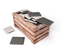 Tablet computers are dumped in an old wooden box Royalty Free Stock Photo