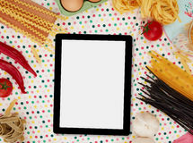 Tablet and cooking ingredients Stock Photography
