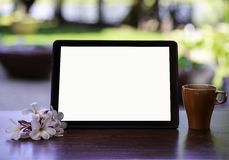 Tablet  and a cup of coffee Royalty Free Stock Photography